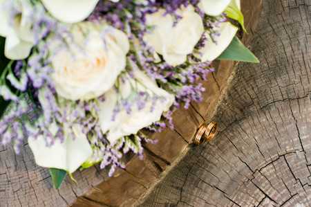 bridal bouquet and newlyweds rings. Stock Photo