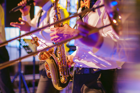 musician plays the saxophone performance at a concert Stock Photo