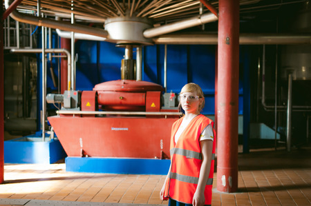 end user: Female worker on beer factory. portrait woman in robe, standing on background line Food production, Inspection management control Equipment for production and bottling finish product end-user buyer