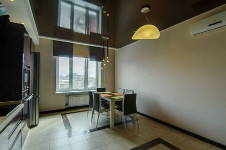 Russia, Moscow- June 17, 2018: interior room apartment. standard repair decoration in hostel. modern kitchen, dining area