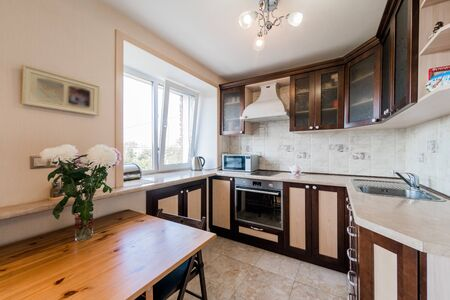 Russia, Moscow- September 08, 2019: interior room apartment modern bright cozy atmosphere. general cleaning, home decoration, preparation of house for sale. kitchen, dining area