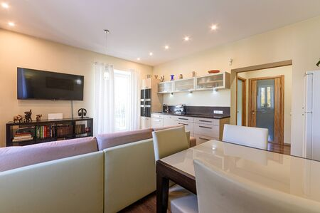 Russia, Moscow- September 10, 2019: interior room apartment modern bright cozy atmosphere. general cleaning, home decoration, preparation of house for sale. kitchen, dining area Editorial