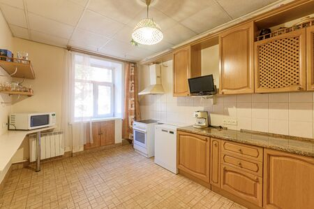 Russia, Moscow- September 10, 2019: interior room apartment modern bright cozy atmosphere. general cleaning, home decoration, preparation of house for sale. kitchen, dining area Редакционное