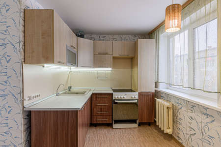 Russia, Moscow- February 07, 2020: interior room apartment modern bright cozy atmosphere. general cleaning, home decoration, preparation of house for sale. kitchen, dining area Editorial