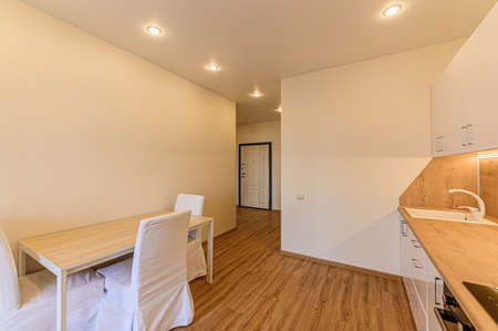 Russia, Moscow- February 10, 2020: interior room apartment modern bright cozy atmosphere. general cleaning, home decoration, modern kitchen, dining area