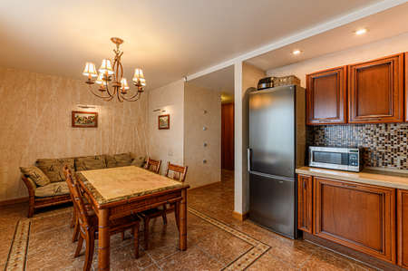 Russia, Moscow- February 10, 2020: interior room apartment modern bright cozy atmosphere. general cleaning, home decoration, kitchen, dining area Editorial