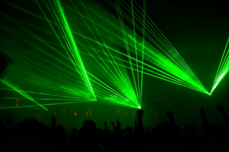 concert stage: bright laser show in the crowd of merry men