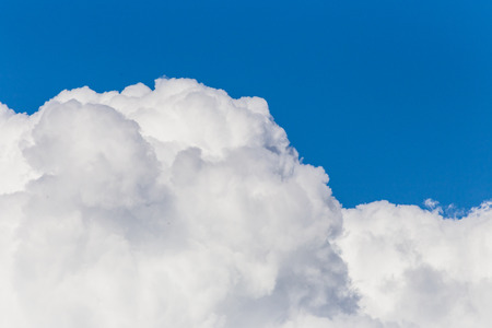 blue sky with white fluffy cloud Stock Photo