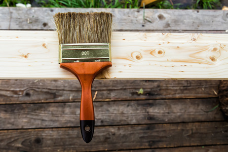 Wood texture and paintbrush  housework background photo