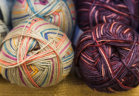 Group of multicolor balls of cotton yarn closeup