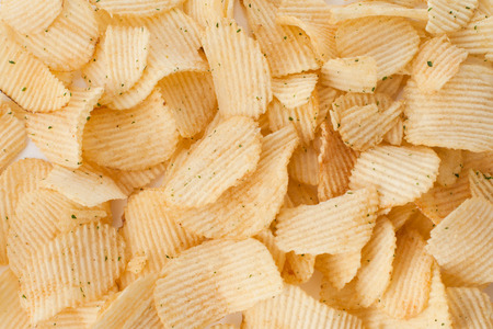 Many Potato  salted chips yellow different shapes Stock Photo