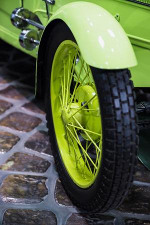 beautiful bright light green retro car wheel Editorial