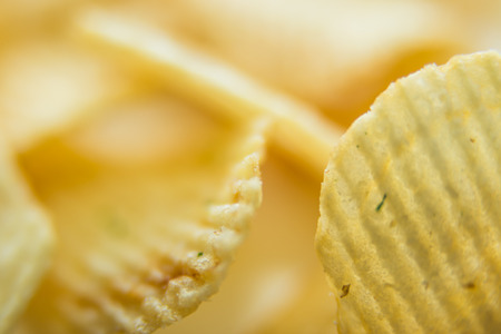 Potato chips bright yellow color is very salty Stock Photo