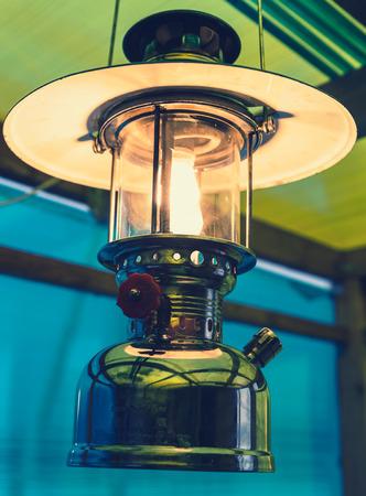 bright beautiful big kerosene lantern hanging in the gazebo in the country Stock Photo