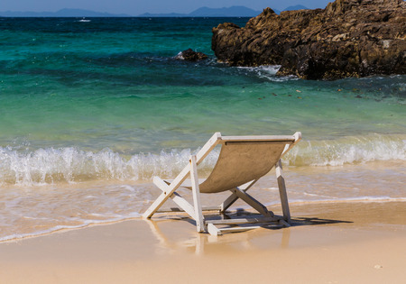 chaise lounge near the sea shore beach Stock Photo