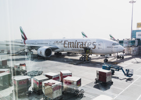 DUBAI - APRIL 10: Boeing 777 Emirats on final approach to DXB airport located in Dubai, April 10, 2015. Emirates is rated as a top10 best airline in the world flying on youngest fleet
