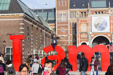 AMSTERDAM - 2 NOVEMBER 2015: The Rijksmuseum Amsterdam museum area with the words IAMSTERDAM is shown in NOVEMBER 2015 in Amsterdam, The Netherlands. The museum first opened to the public in 1800.