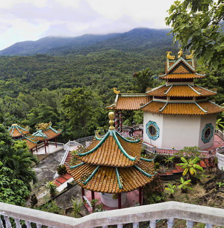 A beautiful view of the temple of the temple of the Goddess of Mercy. The only Chinese temple on the island in Chaloklum, Koh Phangan, Thailand. Show the decorative orange roof of the main pagoda and the surrounding jungle, july 1, 2017 Editorial