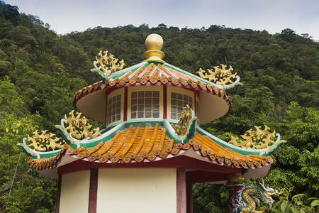 A beautiful view of the temple of the temple of the Goddess of Mercy. The only Chinese temple on the island in Chaloklum, Koh Phangan, Thailand. Show the decorative orange roof of the main pagoda and the surrounding jungle, july 1, 2017 Stock Photo