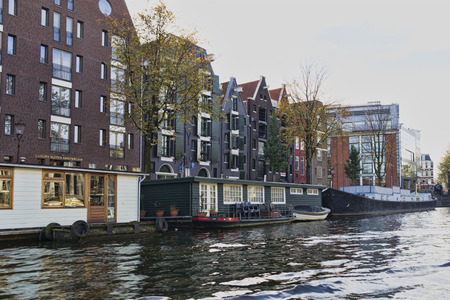 Netherlands, Holland, Amsterdam, November 3, 2015, the way through the Amsterdam channels. Architecture and boats in which people live.
