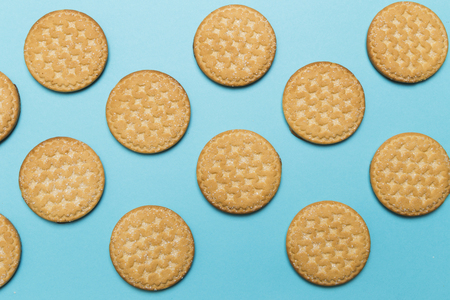 cookies with Saar on a blue background in a checkerboard pattern Stock Photo