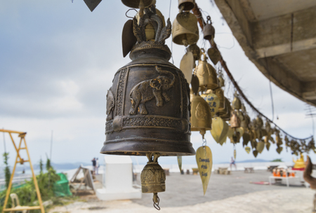 Thailand, Phuket, April 20, 2015, bells to scare away evil spirits and Buddhism in Thailand Stockfoto