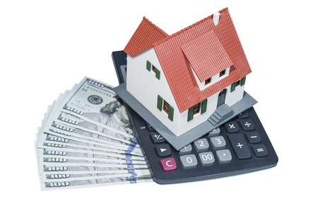 House stand on money and  calculator(clipping path included) photo