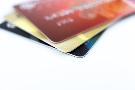 Cropped section of credit card with selective focus photo