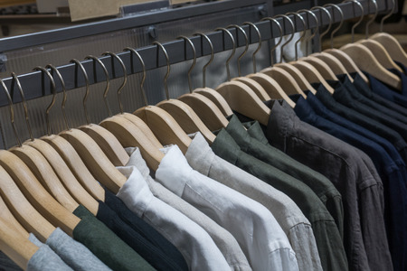 dry cleaner: hangers in fashion clothes shop Stock Photo