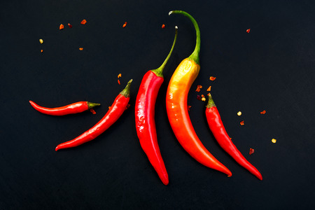 Chili peppers on a black background Imagens - 46018450