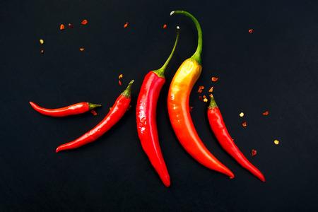 pimientos: Pimientos de chile en un fondo negro Foto de archivo