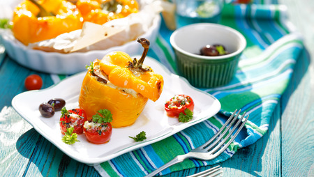 Roasted bell pepper stuffed with quinoa, mushrooms and cheddar cheese with addition aromatic tomatoes