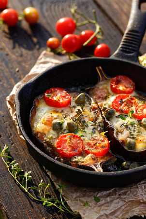 italian: Roasted eggplant stuffed with organic vegetables and cheese with aromatic herbs. Delicious vegetarian dish