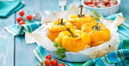 Roasted yellow peppers stuffed with quinoa, mushrooms and cheese. A delicious and healthy vegetarian meal