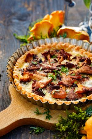 Quiche with chanterelle mushrooms and fresh savory Standard-Bild