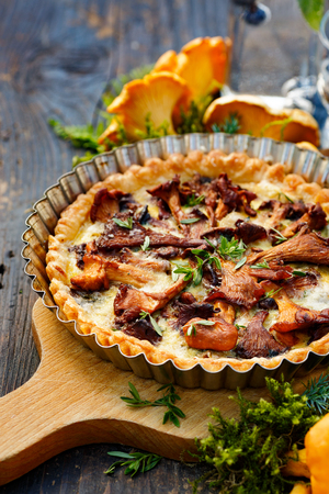 Quiche with chanterelle mushrooms and fresh savory Stock Photo