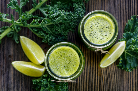 juicing: Fresh kale juice with addition of lime and apple