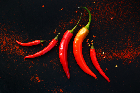 Chili peppers on a black background Stockfoto