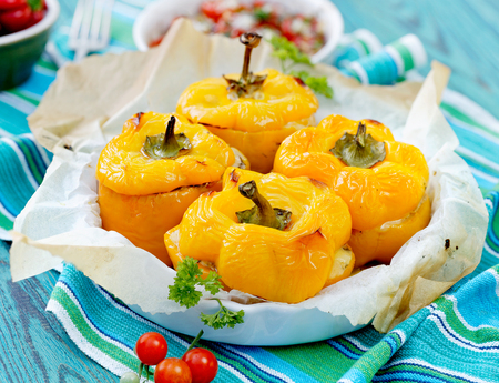 Roasted yellow bell peppers stuffed with quinoa, mushrooms and cheddar cheese