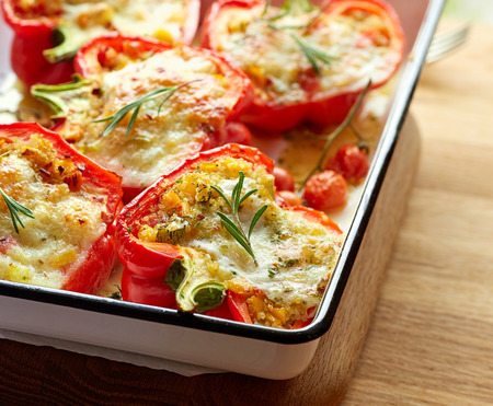 Roasted peppers stuffed with quinoa, vegetables and cheese. Vegetarian dish, healthy and nutritious