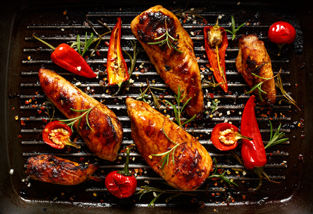 Grilled chicken breast spiced with chili peppers and rosemary