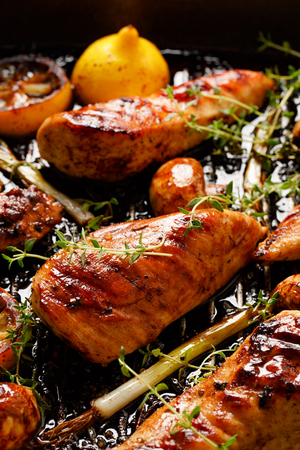 chicken breast: Grilled chicken breast with thyme, lemon and vegetables Stock Photo