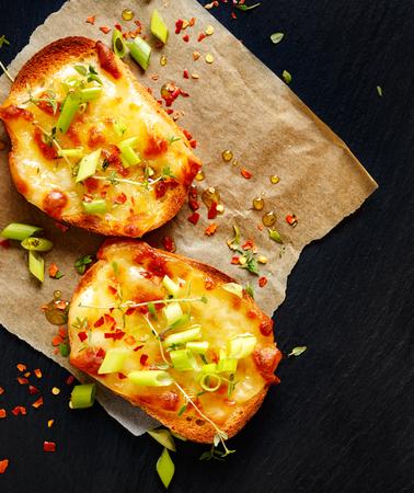 scallions: Crostini with cheese, scallions, chili and fresh thyme