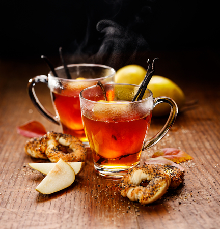 warm drink: Hot tea with ripe pears and vanilla, delicious and aromatic Stock Photo
