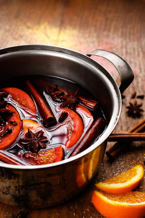 mulled: Mulled red wine with Addition of spices and oranges in a pot