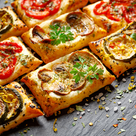 mini oven: Small vegetable tarts with puff pastry, tomato, mushrooms and zucchini