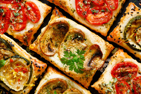 mini oven: Tasty snacks puff pastry with tomatoes, mushrooms and zucchini