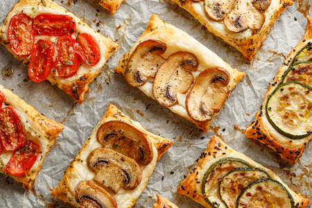 Puff pastry appetizers with vegetables; mushrooms, tomatoes and zucchini