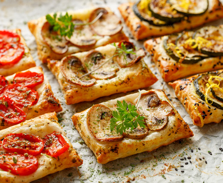appetizers: Puff pastry appetizers with vegetables; mushrooms, tomatoes and zucchini