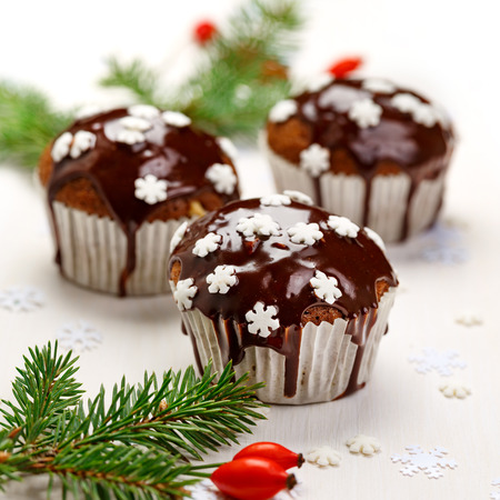 muffin: Christmas chocolate muffins on a white background